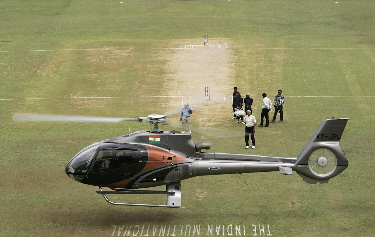 GAUHATI, INDIA - APRIL 09:  A helicopter tries to dry the pitch after heavy overnight rain during the Fifth One Day International match between India and England at the Neheru Stadium on April 9, 2006 in Gauhati, India.  (Photo by Tom Shaw/Getty Images)