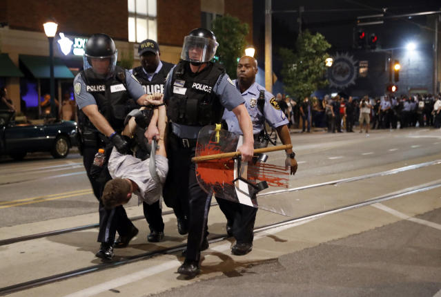 <p>Police arrest a man as they try to clear a violent crowd Saturday, Sept. 16, 2017, in University City, Mo. Earlier, protesters marched peacefully in response to a not guilty verdict in the trial of former St. Louis police officer Jason Stockley. (Photo: Jeff Roberson/AP) </p>
