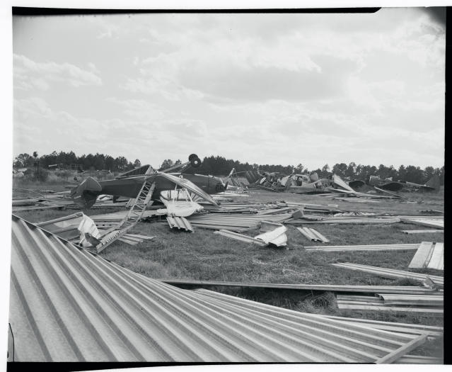 "<p>Former ""T"" hangars for private planes at Raleigh Municipal Airport after being hit by Hurricane Hazel in North Carolina in October, 1954. (Photo from Getty Images) </p>"