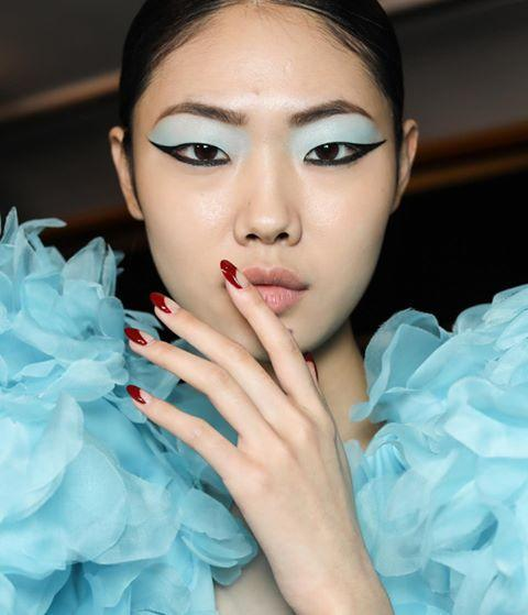 """<p>Manicurist Miss Pop painted graphic red nails with a cool negative space moment on the models backstage at Prabal Gurung. </p><p>Zoya nail polish in Alyssa, $10, <a href=""""https://www.amazon.com/ZOYA-Nail-Polish-Alyssa-0-5/dp/B07DYDD498"""" rel=""""nofollow noopener"""" target=""""_blank"""" data-ylk=""""slk:amazon.com"""" class=""""link rapid-noclick-resp"""">amazon.com</a>. <a class=""""link rapid-noclick-resp"""" href=""""https://www.amazon.com/ZOYA-Nail-Polish-Alyssa-0-5/dp/B07DYDD498?tag=syn-yahoo-20&ascsubtag=%5Bartid%7C10056.g.32631960%5Bsrc%7Cyahoo-us"""" rel=""""nofollow noopener"""" target=""""_blank"""" data-ylk=""""slk:SHOP"""">SHOP</a></p><p><a href=""""https://www.instagram.com/p/B8fZFxwlol4/"""" rel=""""nofollow noopener"""" target=""""_blank"""" data-ylk=""""slk:See the original post on Instagram"""" class=""""link rapid-noclick-resp"""">See the original post on Instagram</a></p>"""