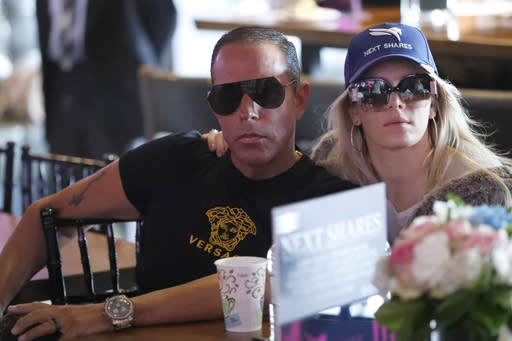 Race horse Next Shares co-owner Michael A. Iavarone and his wife Jules watch the draw for the Pegasus World Cup Horse Race, Wednesday, Jan. 22, 2020, in Hallandale Beach, Fla. The race will run Saturday, Jan. 25 at Gulfstream Park in Hallandale Beach. (AP Photo/Wilfredo Lee)