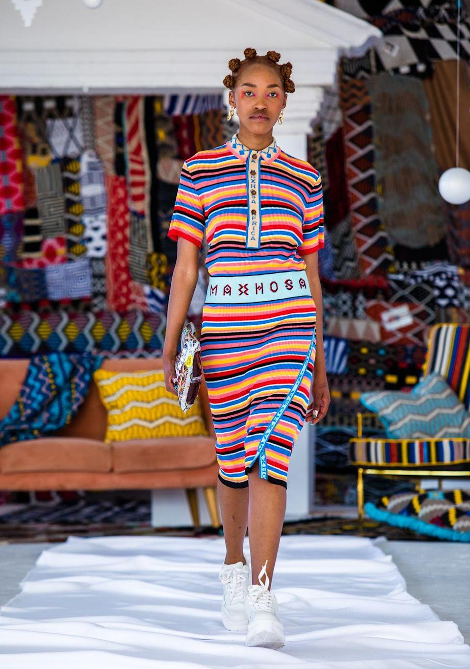 """<p>Though 10 years in business and with fans that includes Beyoncé's stylist, Zerina Akers, Maxhosa Africa has mostly flown under the radar. But with his spring 2021 collection, South African designer Laduma Ngxokolo intends to get his vision across loud and clear. """"In the midst of sadness, it is very important to give people hope,"""" Ngxokolo said at the end of a runway video that was prerecorded in Capetown. """"Happiness is a new luxury."""" The collection, dubbed <em>Ingumangaliso Imisebenzi Ka Thixo</em> (which translates to """"God's Work Is Miraculous""""), Xhosa, manifested this sentiment via vibrant colors, rich knit fabrics, and playful patterns. From column dresses to crop tops paired with bodycon skirts to relaxed, yet refined suits, Ngxokolo transformed wardrobe staples into eye-catching looks that celebrated triumph over darkness. <em>—Barry Samaha</em></p>"""