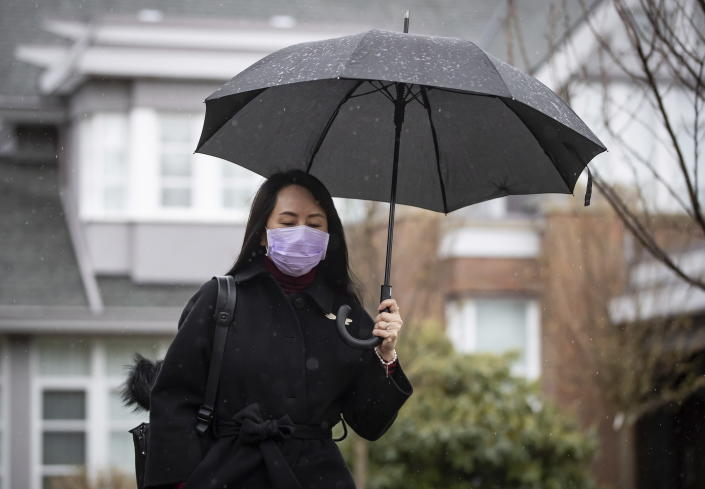 Meng Wanzhou, chief financial officer of Huawei, leaves her home to attend a hearing at B.C. Supreme Court, in Vancouver, B.C., Friday, March 19, 2021. (Darryl Dyck/The Canadian Press via AP)