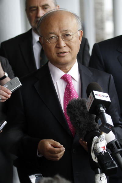 """Director General of the International Atomic Energy Agency, IAEA, Yukiya Amano, right, from Japan speaks to the media after returning from Iran at the Vienna International Airport near Schwechat, Austria, on Tuesday, May 22, 2012. Amano says he has reached a deal with Iran on probing suspected work on nuclear weapons and adds that the agreement will """"be signed quite soon."""" (AP Photo/Ronald Zak)"""