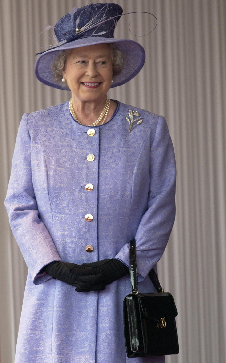 Queen Elizabeth II accessorises with a Launer bag as she meets the American President at Buckingham Palace in 2003