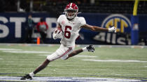 FILE - In this Saturday, Dec. 19, 2020, file photo, Alabama wide receiver DeVonta Smith (6) runs against Florida during the first half of the Southeastern Conference championship NCAA college football game in Atlanta. Smith has been named a finalist for the Heisman Trophy. The Heisman will be awarded Jan. 5 during a virtual ceremony as the pandemic forced the cancellation of the usual trip to New York that for the presentation that usually comes with being a finalist. (AP Photo/Brynn Anderson, File)