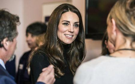 Catherine, Duchess of Cambridge speaks with staff members during a visit to the Nelson trust women's centre in Gloucester