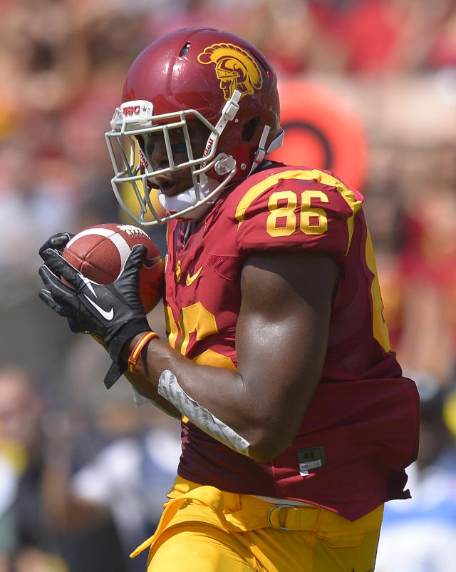 Southern California tight end Xavier Grimble makes a touchdown catch during the first half of an NCAA college football game against Utah State, Saturday, Sept. 21, 2013, in Los Angeles. (AP Photo/Mark J. Terrill)