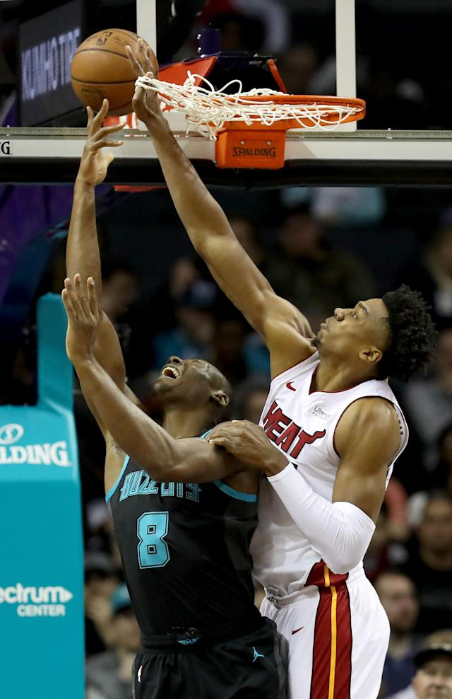 CHARLOTTE, NORTH CAROLINA - MARCH 06: Hassan Whiteside #21 of the Miami Heat tries to stop Bismack Biyombo #8 of the Charlotte Hornets during their game at Spectrum Center on March 06, 2019 in Charlotte, North Carolina. (Photo by Streeter Lecka/Getty Images)