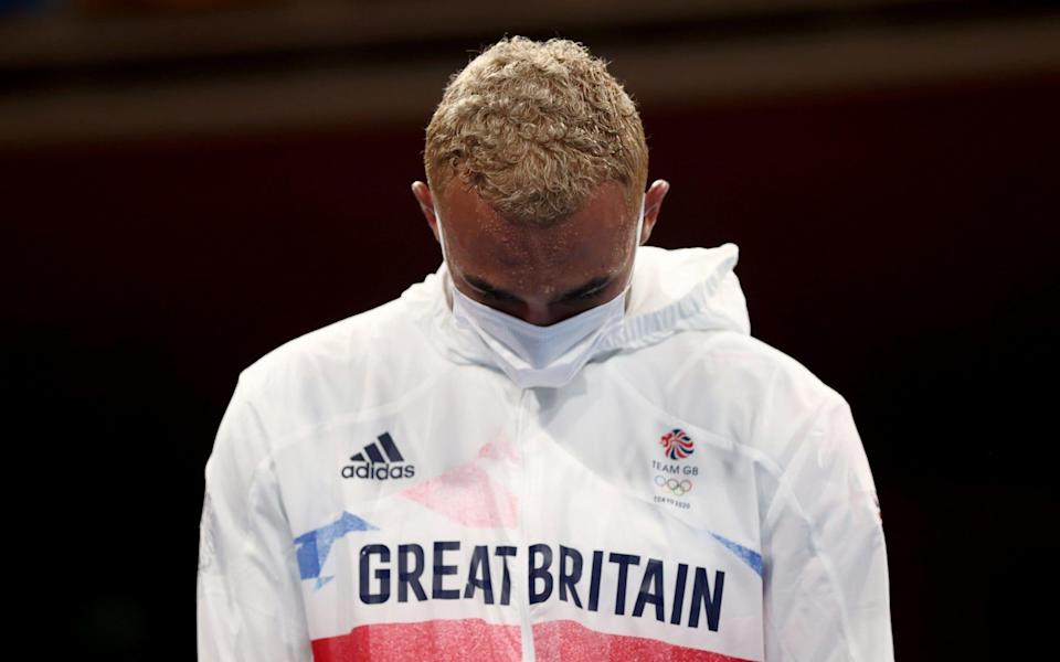 Silver medallist Benjamin Whittaker of Britain looks dejected during the medal ceremony - REUTERS