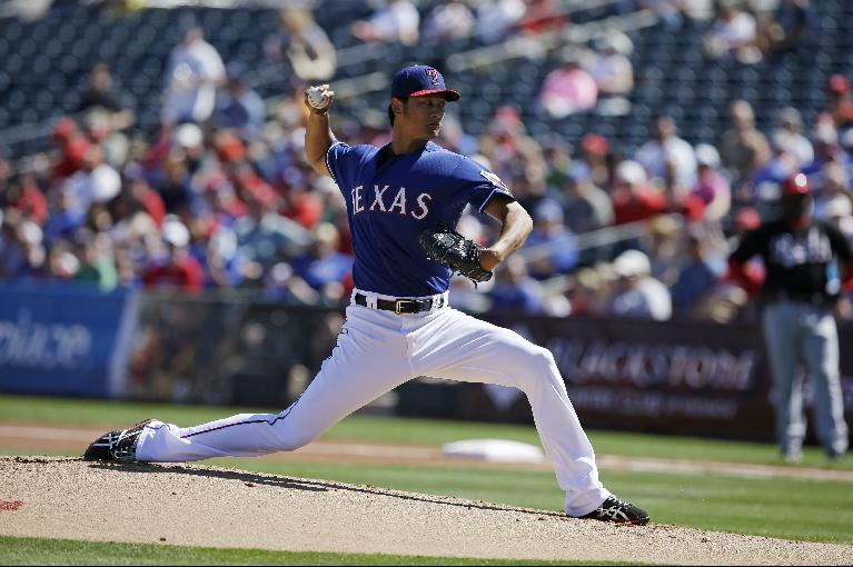 Texas Rangers starting pitcher Yu Darvish throws during a spring exhibition baseball game against the Cincinnati Reds Tuesday, March 11, 2014, in Suprise, Ariz. (AP Photo/Darron Cummings)