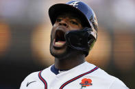 Atlanta Braves' Guillermo Heredia reacts after driving in a run with a base hit in the sixth inning of a baseball game against the Washington Nationals, Monday, May 31, 2021, in Atlanta. (AP Photo/John Bazemore)