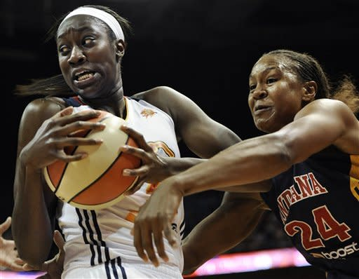 Connecticut Sun's Tina Charles, left, is pressured by Indiana Fever's Tamika Catchings during the first half of Game 3 of the WNBA basketball Eastern Conference finals in Uncasville, Conn., Thursday, Oct. 11, 2012. (AP Photo/Jessica Hill)