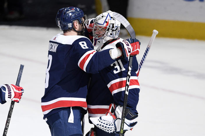 Washington Capitals goaltender Craig Anderson (31) reacts with left wing Alex Ovechkin (8), of Russia, after an NHL hockey game against the New Jersey Devils, Sunday, Feb. 21, 2021, in Washington. (AP Photo/Nick Wass)
