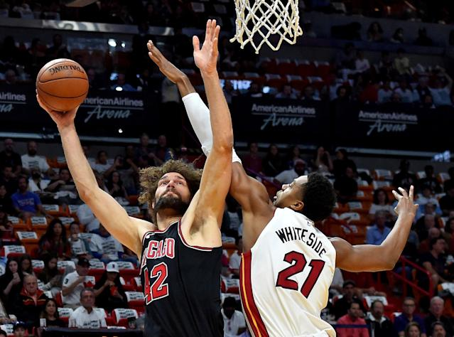 Mar 29, 2018; Miami, FL, USA; Chicago Bulls center Robin Lopez (42) shoots defended by Miami Heat center Hassan Whiteside (21) during the first half of an NBA game at American Airlines Arena. Mandatory Credit: Steve Mitchell-USA TODAY Sports TPX IMAGES OF THE DAY