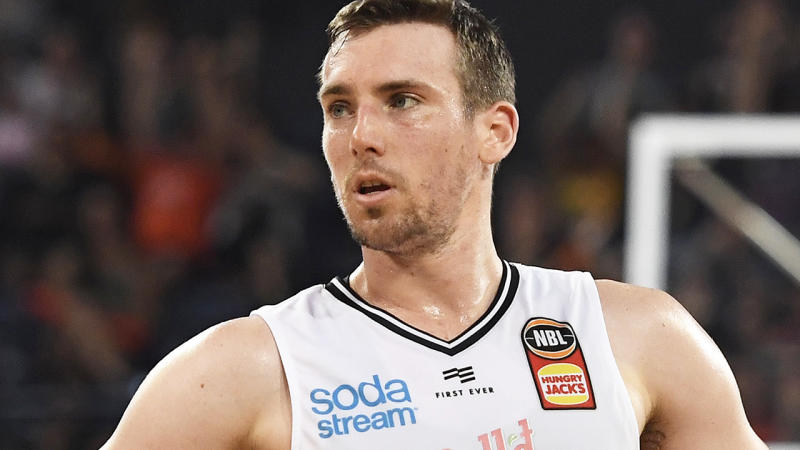 Mitch McCarron and Melbourne United teammate Jo Lual-Acui have tested positive for the coronavirus, prompting the NBL to shut down approved training for them and the South-East Melbourne Phoenix. (Photo by Ian Hitchcock/Getty Images)