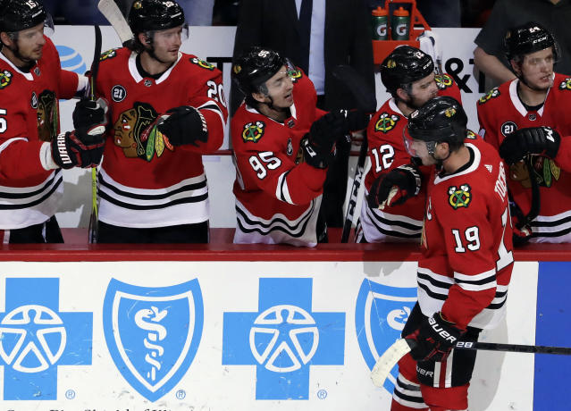 Chicago Blackhawks center Jonathan Toews (19) celebrates with teammates after scoring a goal against the New Jersey Devils during the second period of an NHL hockey game Thursday, Feb. 14, 2019, in Chicago. (AP Photo/Nam Y. Huh)