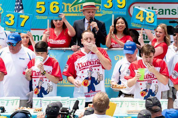 People have been stuffing hot dogs down their gullets for 102 years!