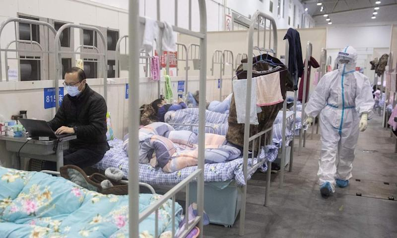 People at an exhibition centre converted into a hospital in Wuhan, China