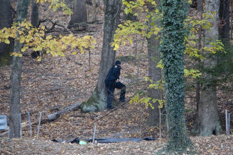 Police officers continue to search the Grandin Road area in the vicinity of Patrick Henry High School, Thursday, Nov. 14, 2019, in Roanoke, Va., for Michael Alexander Brown, a Marine deserter wanted for questioning in a murder case. (Stephanie Klein-Davis/The Roanoke Times via AP)
