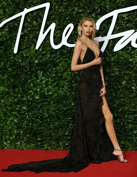 Stella Maxwell upped the temperature in a long skinny strap dress with a  plunging neckline by Etro. London, December 2, 2019
