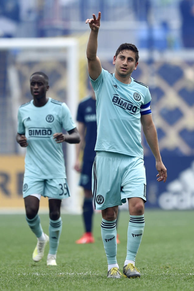 Philadelphia Union's Alejandro Bedoya points to the crowd after scoring a goal during the second half of an MLS soccer match against the Montreal Impact, Saturday, April 20, 2019, in Chester, Pa. The Union won 3-0. (AP Photo/Derik Hamilton)