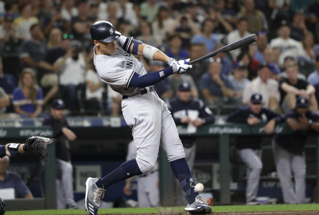New York Yankees' Aaron Judge singles against the Seattle Mariners during the sixth inning of a baseball game Tuesday, Aug. 27, 2019, in Seattle. (AP Photo/Elaine Thompson)