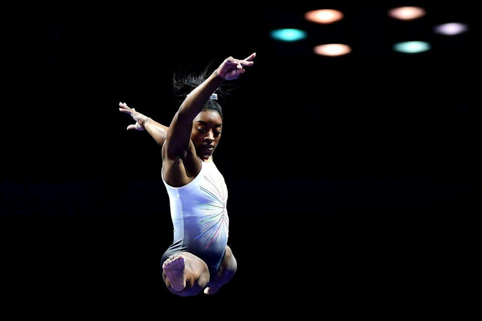 """<p><strong>Age: </strong>24</p><p><strong>Hometown: </strong>Spring, Texas </p><p>The most famous gymnast on the U.S. team, Simone Biles was widely expected to bring home gold. However, Biles, who is recognized as the best gymnast in the world, withdrew from the competition for mental health reasons. Biles made headlines earlier this summer as the first woman to perform the <a href=""""https://www.townandcountrymag.com/leisure/sporting/a36518750/simone-biles-yurchenko-double-pike-vault-history-us-classic/"""" rel=""""nofollow noopener"""" target=""""_blank"""" data-ylk=""""slk:Yurchenko double pike vault"""" class=""""link rapid-noclick-resp"""">Yurchenko double pike vault</a> in competition, and, thus far, only men have completed it at the Olympics. Though Biles skipped the all-around and three individual events, she returned to competition <a href=""""https://www.townandcountrymag.com/leisure/sporting/a37198924/simone-biles-balance-beam-tokyo-olympics-2021/"""" rel=""""nofollow noopener"""" target=""""_blank"""" data-ylk=""""slk:for the balance beam"""" class=""""link rapid-noclick-resp"""">for the balance beam</a>, where she won a bronze medal. </p>"""