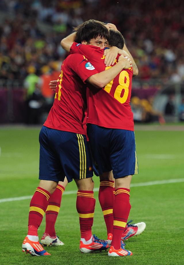 KIEV, UKRAINE - JULY 01: David Silva (L) of Spain celebrates with his team-mate Jordi Alba after scoring the opening goal during the UEFA EURO 2012 final match between Spain and Italy at the Olympic Stadium on July 1, 2012 in Kiev, Ukraine. (Photo by Shaun Botterill/Getty Images)