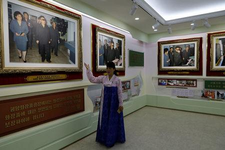 A guide gives foreign reporters a tour of an exhibition to commemorate visits by North Korean leaders Kim Jng Il and Kim Jong Un to a cosmetic factory in Pyongyang