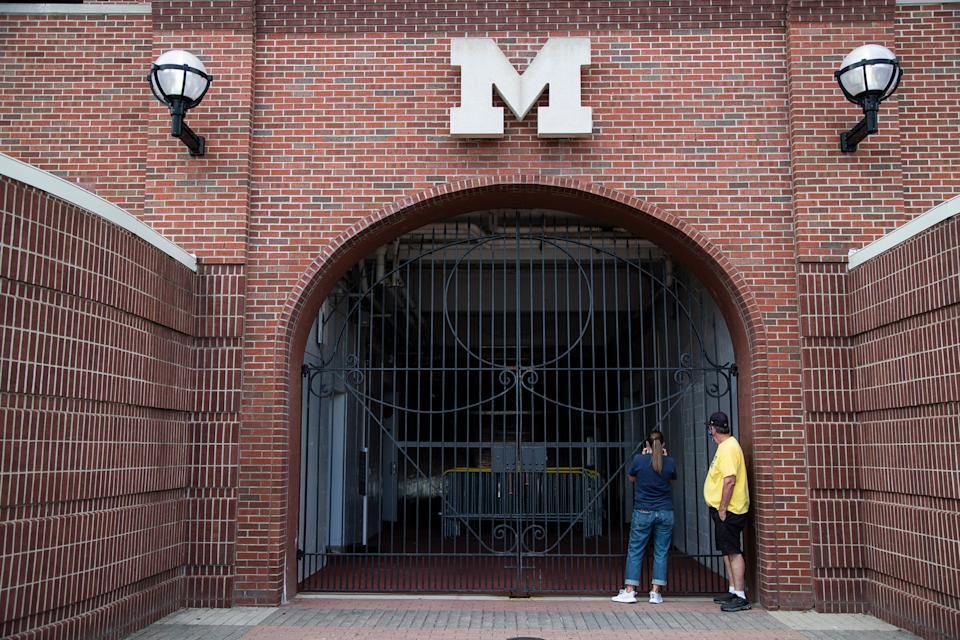 U-M football players' parents, supporters and some players and coaches gather outside of the Michigan Stadium in Ann Arbor to protest the postponement of the fall football season on Sept. 5, 2020.