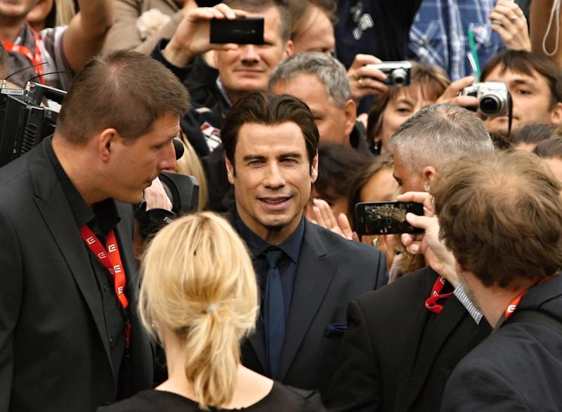 U.S. actor John Travolta arrives at the opening of the 48th Karlovy Vary International Film Festival in Karlovy Vary, Czech Republic, Friday, June 28, 2013. (AP Photo/CTK, Pavel Nemecek) SLOVAKIA OUT