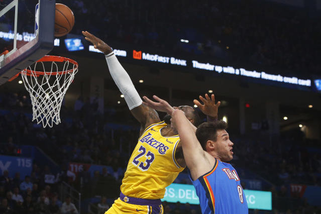 Los Angeles Lakers forward LeBron James (23) loses the ball after a foul by Oklahoma City Thunder forward Danilo Gallinari (8) during the first half of an NBA basketball game Friday, Nov. 22, 2019, in Oklahoma City. (AP Photo/Sue Ogrocki)