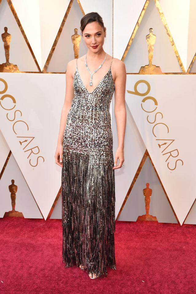 The star of <i>Wonder Woman</i> wasn't nominated for an Oscar, but she certainly shone in a silver Givenchy gown. (Photo: Getty Images)