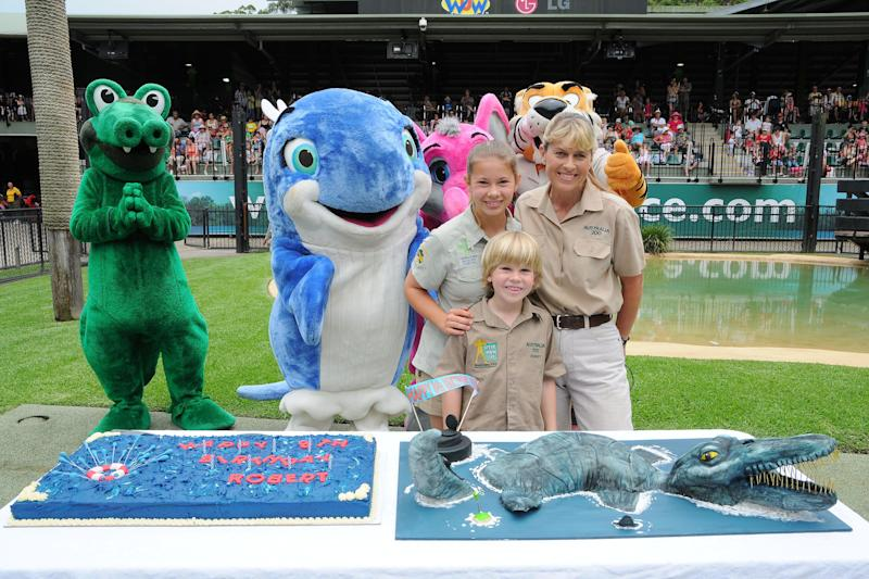 In this handout photo provided by Australia Zoo, Robert Irwin celebrates his eighth birthday with sister Bindi (L) and mother Terri Irwin, at Australia Zoo, on December 1, 2011 in Beerwah, Australia. (Photo by Australia Zoo via Getty Images)
