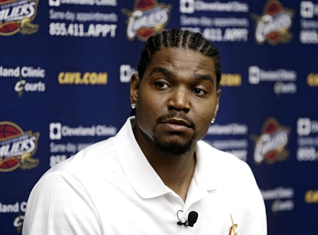 FILE - In this July 19, 2013 file photo, Cleveland Cavaliers' Andrew Bynum listens to a question during an NBA basketball news conference in Independence, Ohio. On Saturday, Feb. 1, 2014, the Pacers added size and scoring punch to their roster by signing mercurial free agent center Andrew Bynum for the rest of the season. Team officials did not release additional details about the contract and said Bynum was expected to join the team sometime next week. (AP Photo/Tony Dejak, File)