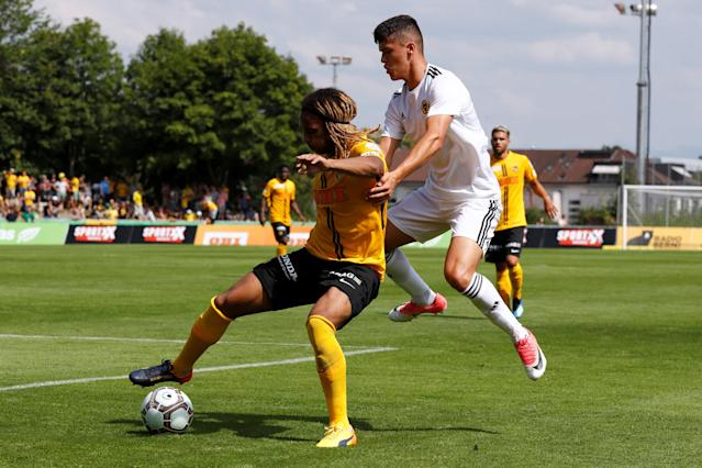 Soccer Football - Uhrencup - BSC Young Boys v Wolverhampton Wanderers - Stadion Neufeld, Bern, Switzerland - July 14, 2018 Young Boys' Kevin Mbabu in action with Wolverhampton Wanderers' Ryan Giles REUTERS/Stefan Wermuth