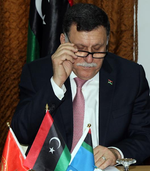 Libya's UN-backed Prime Minister-designate, Fayez al-Sarraj, pictured during a meeting with members of the presidential council in the capital Tripoli on March 31, 2016 (AFP Photo/Mahmud Turkia)