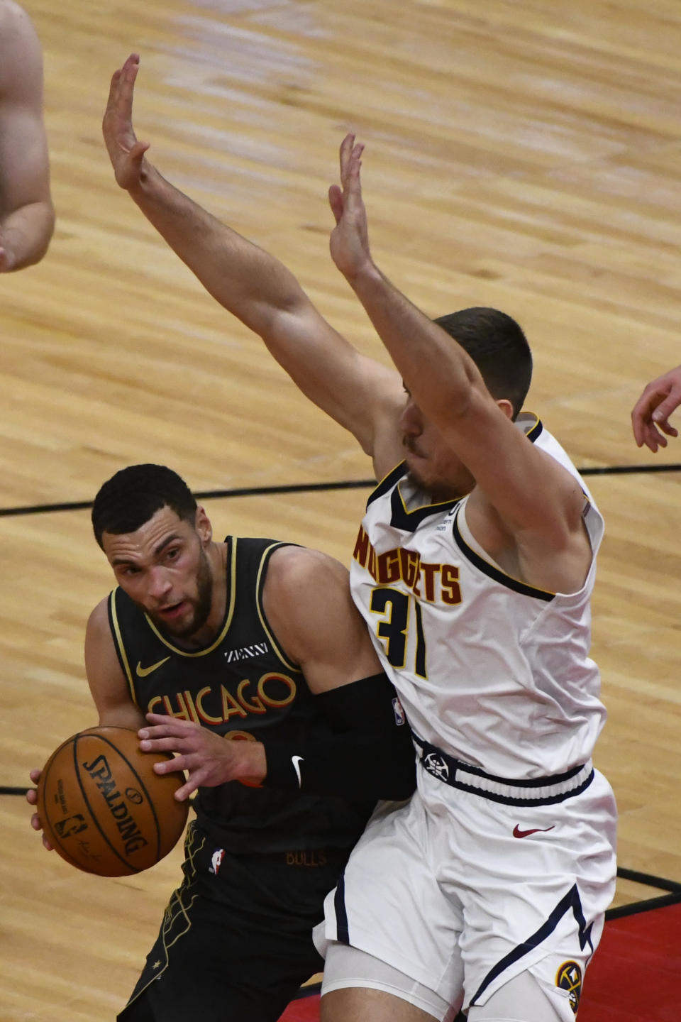 Chicago Bulls guard Zach LaVine, left, drives to the basket against Denver Nuggets forward Vlatko Cancar (31) during the first half of an NBA basketball game Monday, March 1, 2021, in Chicago. (AP Photo/Matt Marton)