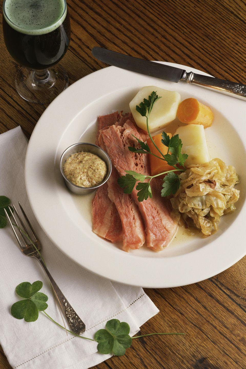 """<p>So it's not exactly authentic, but this meal has become part of the American tradition on St. Paddy's Day because, well, it's delicious.</p><p><em><a href=""""https://www.goodhousekeeping.com/recipefinder/corned-beef-cabbage-potatoes-2505"""" rel=""""nofollow noopener"""" target=""""_blank"""" data-ylk=""""slk:Get the recipe Corned Beef with Cabbage and Potatoes »"""" class=""""link rapid-noclick-resp"""">Get the recipe Corned Beef with Cabbage and Potatoes »</a></em> </p>"""
