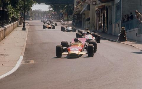 Graham Hill's Lotus leading John Surtees' Honda, Monaco Grand Prix, 1968. Hill went on to win the race to help him on the way to his second World Drivers' Championship, while Surtees pulled out after 16 laps with gearbox failur - Credit: Hulton Archive