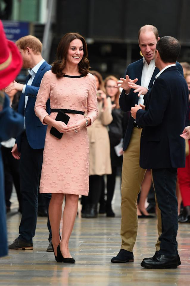 <p>For a surprise appearance at Paddington Station, the Duchess donned a light pink dress and new haircut. </p>