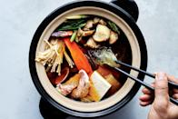 """Chicken, seafood, glass noodles, and vegetables get briefly poached in dashi-based broth. Cutting the ingredients into uniform pieces ensures they cook in the same amount of time. <a href=""""https://www.epicurious.com/recipes/food/views/anything-goes-donabe?mbid=synd_yahoo_rss"""" rel=""""nofollow noopener"""" target=""""_blank"""" data-ylk=""""slk:See recipe."""" class=""""link rapid-noclick-resp"""">See recipe.</a>"""
