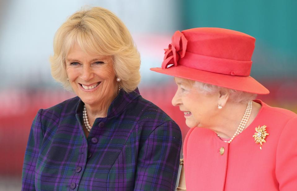 LONDON, ENGLAND - OCTOBER 29:  Queen Elizabeth II and Camilla, Duchess of Cornwall share a joke as they visit Ebony Horse Club & Community Riding Centre in Brixton during a joint visit on October 29, 2013 in London, England.  (Photo by Chris Jackson/Getty Images)