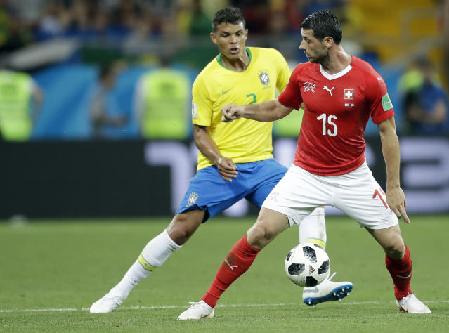 Switzerland's Blerim Dzemaili, right, and Brazil's Thiago Silva challenge for the ball during the group E match between Brazil and Switzerland at the 2018 soccer World Cup in the Rostov Arena in Rostov-on-Don, Russia, Sunday, June 17, 2018. (AP Photo/Felipe Dana)
