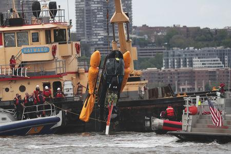 A section of a Helicopter that crashed into the Hudson River is pulled out of the Hudson River in New York City, U.S., May 15, 2019. REUTERS/Shannon Stapleton