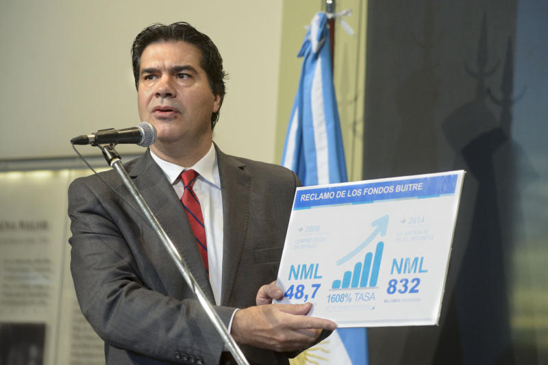 "A picture released by the Argentine Ministries Cabinet press service of the head of the Ministries Cabinet, Jorge Capitanich, speaking about the ""vulture funds"" in Buenos Aires on June 17, 2014"
