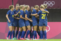 Sweden's players celebrate after Sweden's Madelen Janogy scores a goal against New Zealand during a women's soccer match between New Zealand and Sweden at the 2020 Summer Olympics, Tuesday, July 27, 2021, in Rifu, Japan. (AP Photo/Andre Penner)