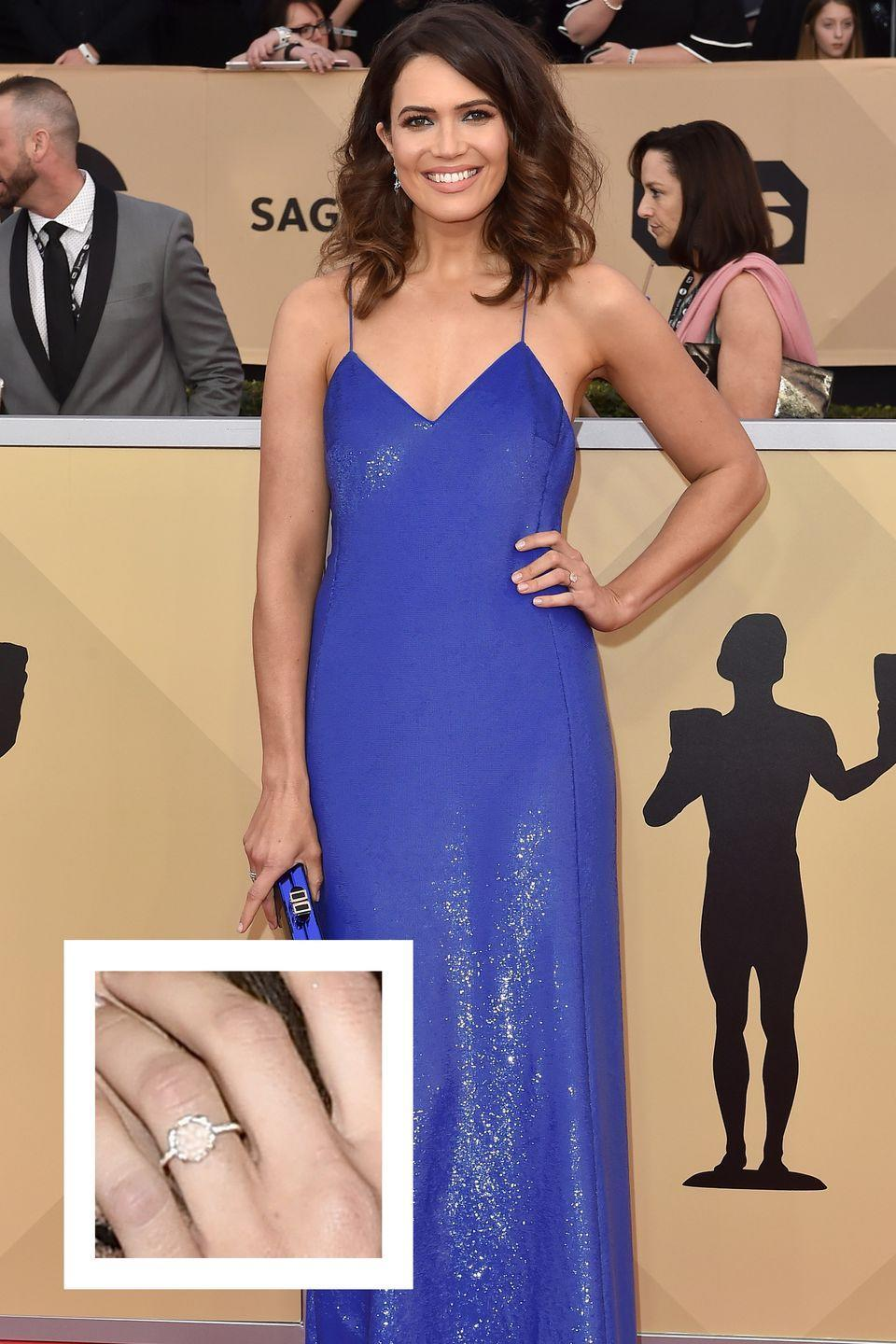 """<p>Moore gave fans a first peek at her engagement ring from musician Taylor Goldsmith at the Emmy Awards in 2017. The round-cut solitaire diamond ring is set in a simple yet elegant rose gold band, <a href=""""http://people.com/style/mandy-moore-engagement-ring/"""" rel=""""nofollow noopener"""" target=""""_blank"""" data-ylk=""""slk:People reports."""" class=""""link rapid-noclick-resp""""><em>People</em> reports.</a></p>"""