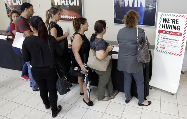 Job seekers wait in line at a job fair at the Dolphin Mall in Sweetwater, Fla. (AP Photo/Alan Diaz)